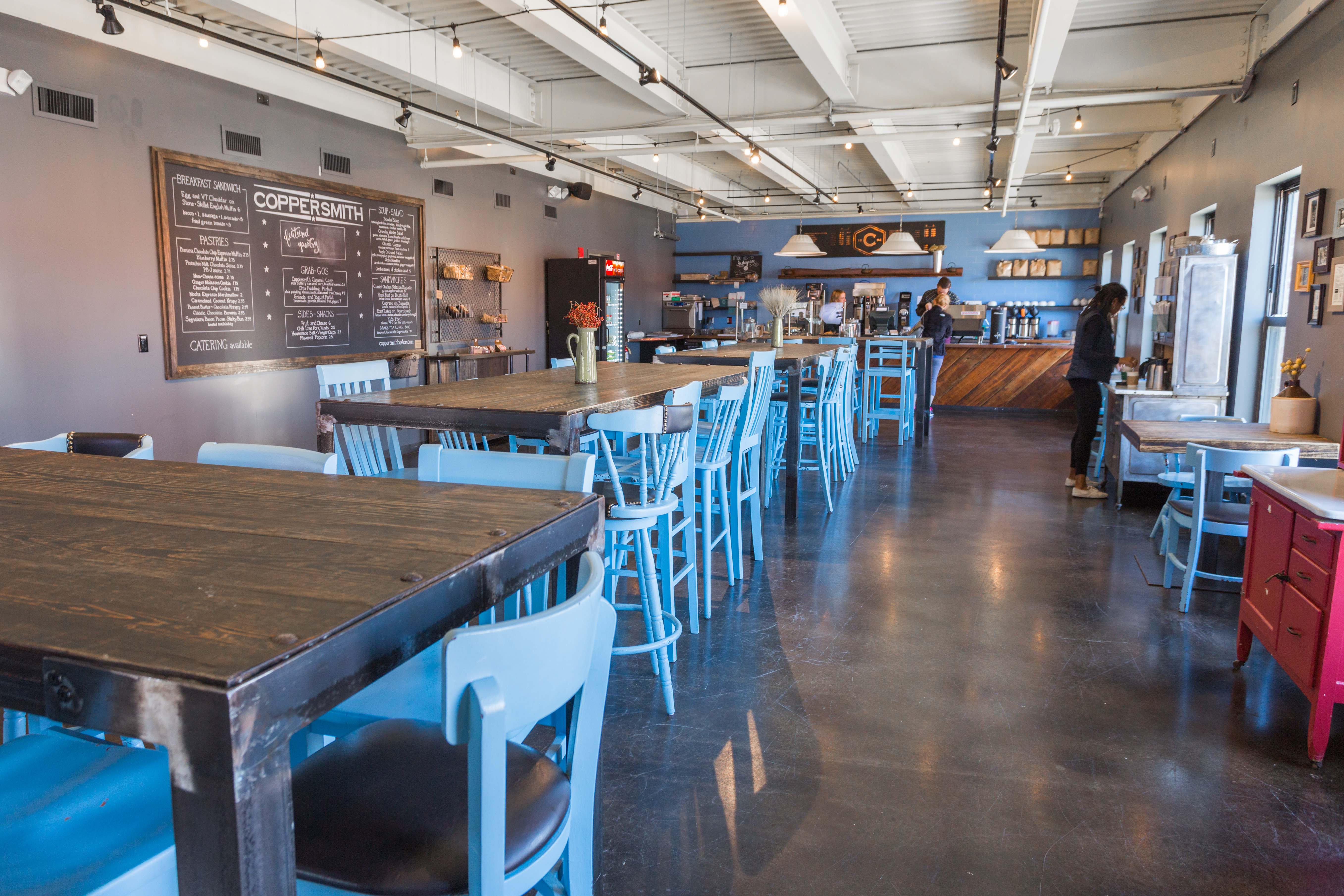 Glass garage doors restaurant -  Atrium Skylights Open Windows And Glass Garage Doors That Together Impart A Bright Sense Of Comfort And Warmth Against Coppersmith S Industrial Feel